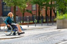 Women in Wheelchair in a street environment