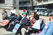 Disabled people protesting for ADA compliance